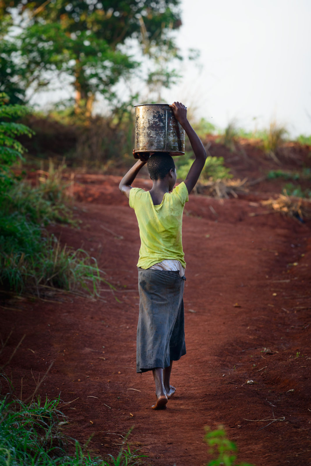 Woman in Water for All's project in Malawi, fetching water.